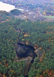 Image of the pond along Sucker Brook that was formed by the gristmill dam, and Lake Wickaboag in the distance. Photo taken by Burchard Aviation 2014.