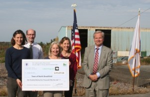 Ann Hicks, from the North Brookfield Conservation Commission, along with state representatives at the grant award ceremony.