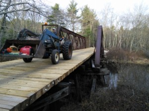 Mark is driving the tractor home after a successful day at the pony truss!