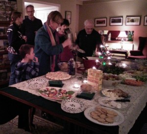 Party goers helping themselves to some goodies during the holiday open house.