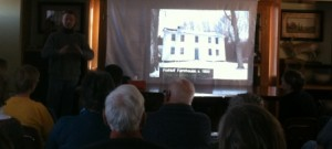 Ed Hood with an image of the Frohloff Farm house, circa 1800.