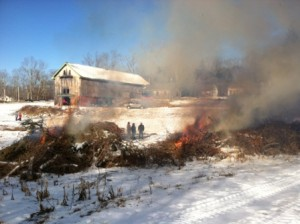 Burning brush piles near the Wendemuth barn.