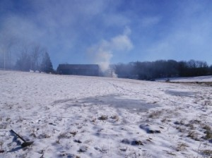 Smoke in the sky above the Wendemuth Meadow barn as brush was burned yesterday.