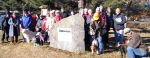 The group standing with the historic marker for the Mass Central Railroad in New Braintree.