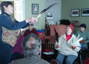 Dianne shows the audience how the primary feathers overlap and aid in eagle flight.