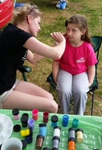 Getting a butterfly. Tigers, cats, Spiderman and skeletons also visited the Family Fun Fest!