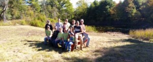 Members of Troop 161 after a full day clearing brush and vegetation around the pond edge. They are sitting on the 8' picnic table Alex and helpers made earlier.