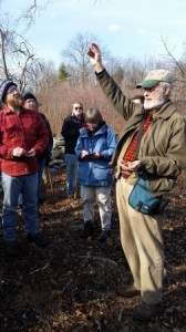 David Brown, naturalist and tracker, showing the group how to identify what type of squirrel ate which hickory nut.