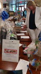 Judy perusing the silent auction items.