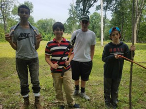 These students help clear brush along McCarthy Road and pile fallen branches to clean up the field.