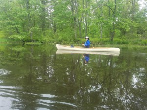 Chris Komenda canoeing down the Ware River.