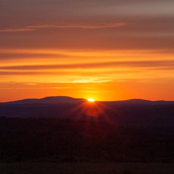 Category 2 - Landscape. Sunrise over Mount Wachusett, taken by Bryan Smith on June 15, 2019 at Mandell Hill
