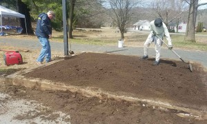 Ken and Becky getting the loam squared away before planting.