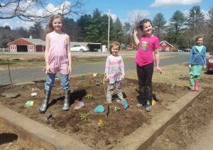 Proud planters with their painted rocks and pollinator plants at the Mass Central Rail Trail