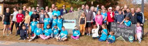 Most of the runners posing at the historic marker for the New Braintree train station, part of the Mass Central Rail Trail