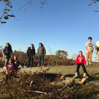 Middle schoolers from the Hardwick Youth Center pose for a photo on a hike at Mandell Hill.